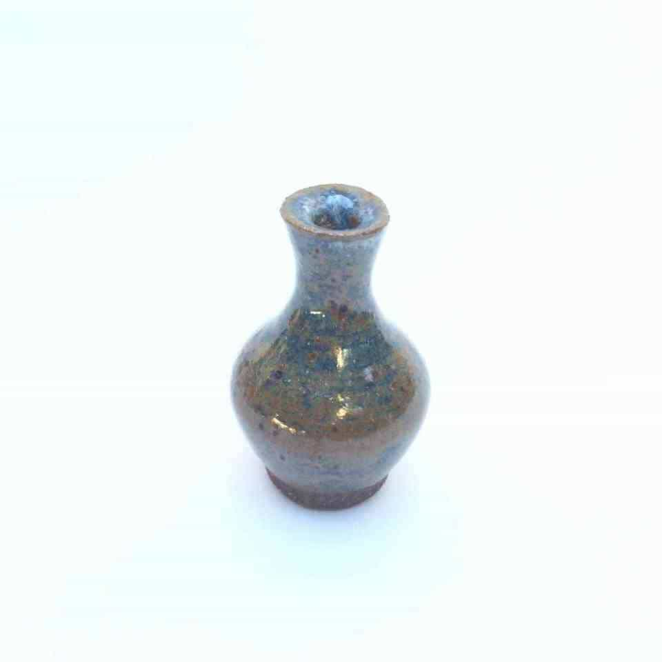 miniature blue and brown bottle styled ceramic vase on a white background