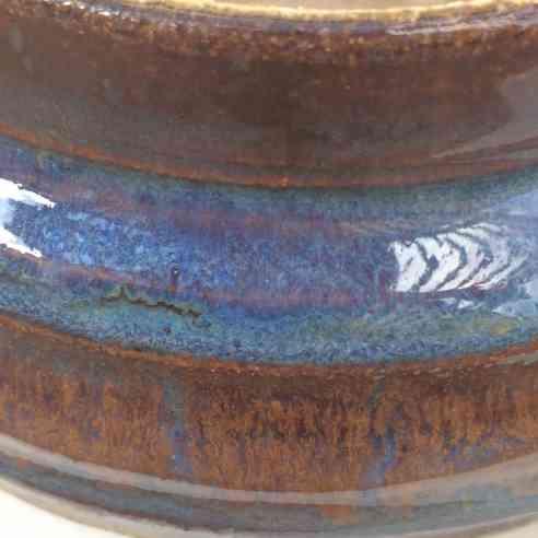 albany slip blue rutile and indigo float amaco cone six potter's choice glaze detail of a mugl