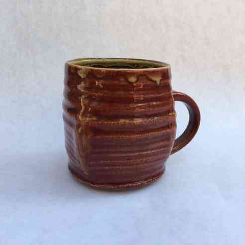 Red Brown Glazed Mug with Handle on a blueish white background